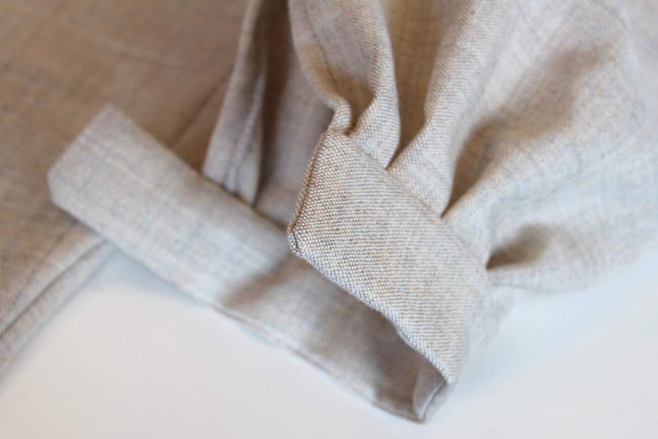 Detalj av linskjorte under sying