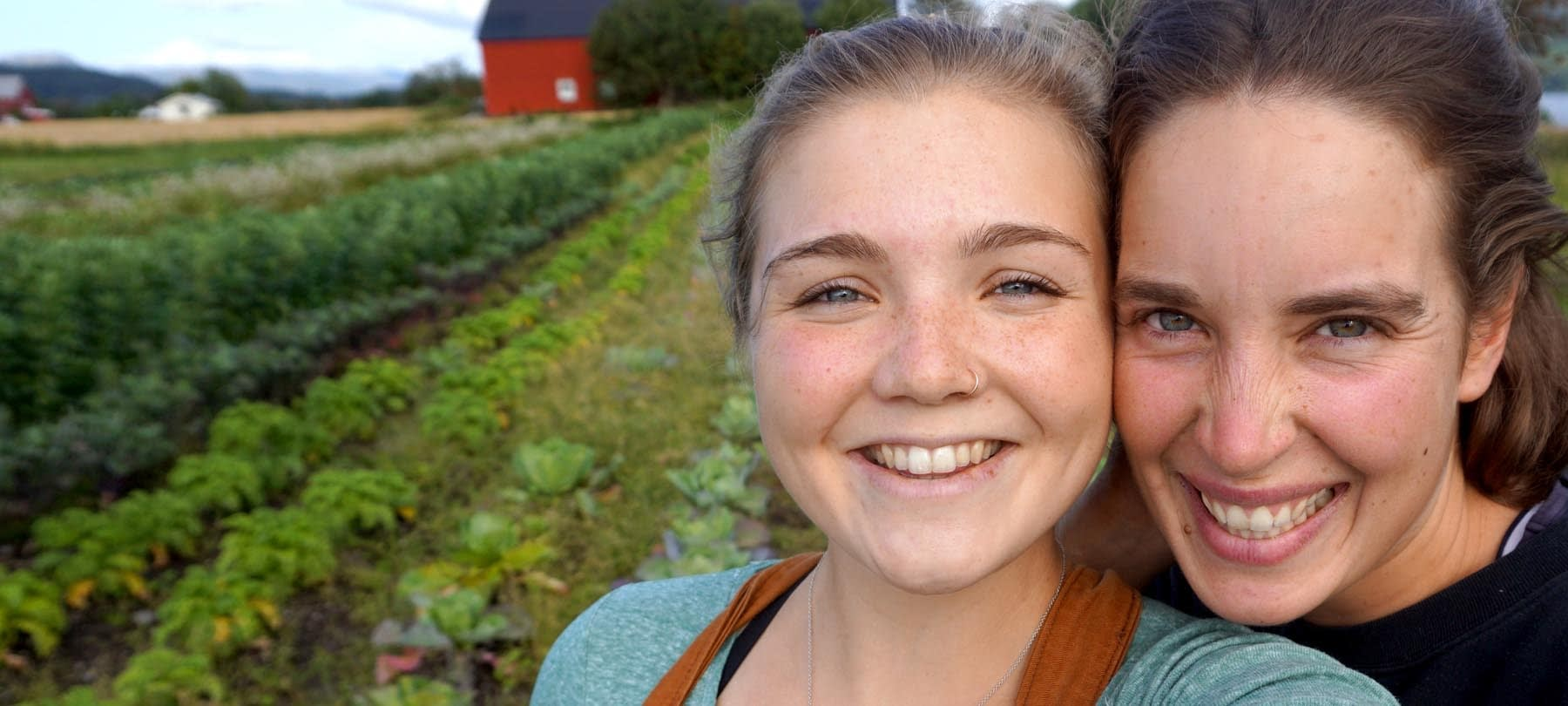 Happy girls in an organic vegetable field
